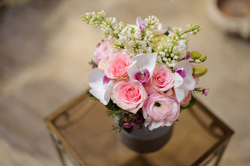 Beautiful violet vintage box of pink roses and another flowers