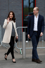 Britain's Prince William and Catherine, Duchess of Cambridge wave as they leave a SportsAid event at the Copper Box in the Olympic Park in Stratford, London