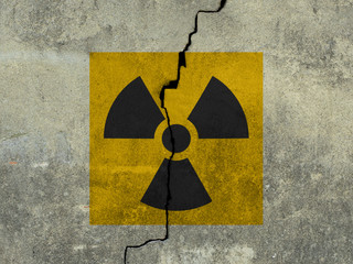 sign of radiation on a concrete wall background.