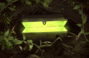 Grün leuchtende Schatztruhe in einer Höhle