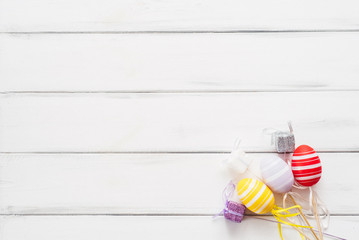 Colorful eggs and presents for Easter on a white background. Flat lay and copy space
