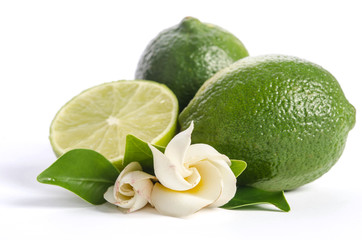 two green limes with half of  juicy lime and beautifull flower isolated on white background