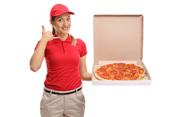 Pizza delivery girl making a call me gesture