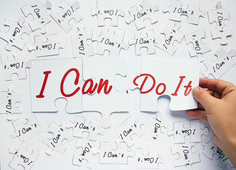 I can do it. Words of motivation. Concept motivational message of ability and possibility. I can`t and i can are written on puzzle pieces.
