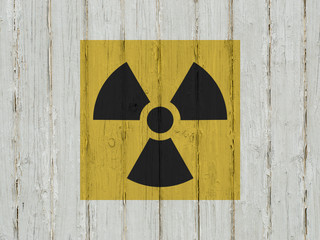 sign of radiation on a wooden background.