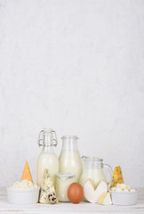 Dairy products on white wooden table vertical composition with copy space