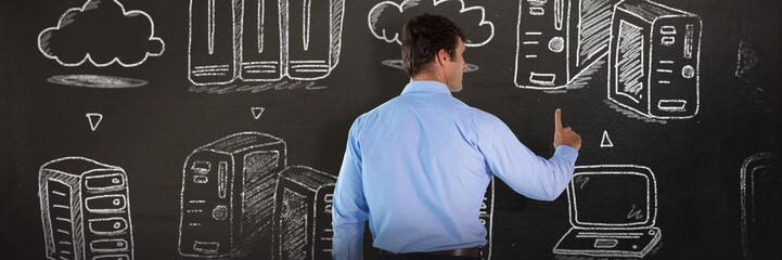 Composite image of rear view of businessman in blue shirt using
