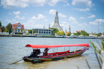 Local passenger ship for tour sailing on river with Thailand Temple background