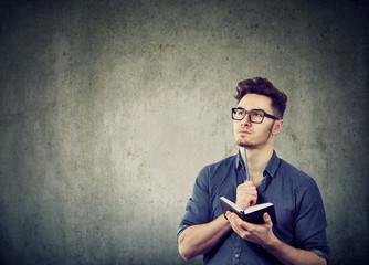 Pondering man creating plans