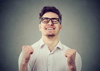 Excited man feeling relief with win
