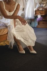 Bride in wedding dress relaxing on a sofa