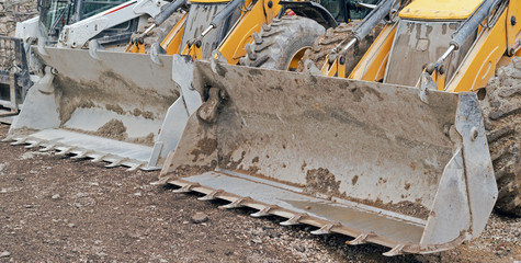 yellow excavator machines