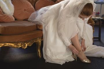Young bride in wedding dress wearing high heels