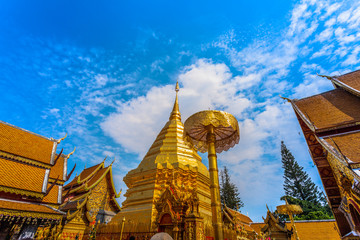 golden pagoda in wat Phrathat Doi Suthep under blue sky.Temple is tourist attraction of Chiang Mai, Thailand.