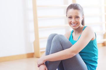 Woman having a break at gym