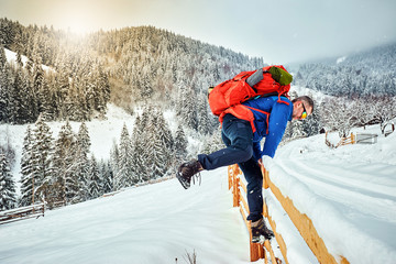 Winter climb to the top of the mountain with a backpack.