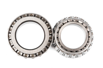 Two precision metal bearings on a white background. top view