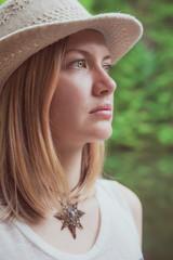 Beautiful woman portrait in hat outdoor