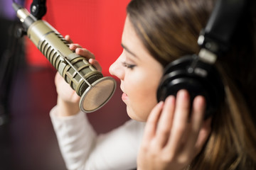 Woman singer face singing in a radio show