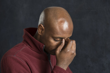Portrait of a black man looking sad, depressed