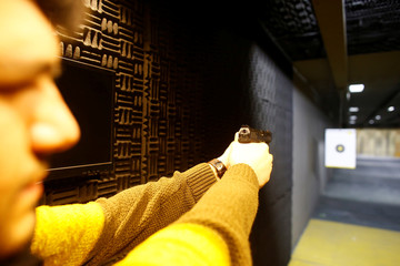 A man prepares to shoot with his Canik TP9, 9 mm handgun during a practice session at a shooting range in Istanbul