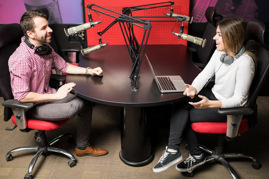 Couple of radio presenters during a live show