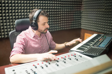 Musician working on composing new melodies