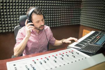 Sound engineer working in soundproof recording studio