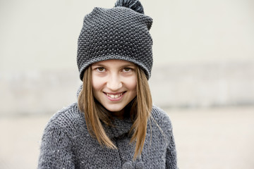 Portrait of a smiling little girl with woolen hat
