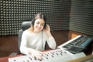 Female sound engineer working in recording studio