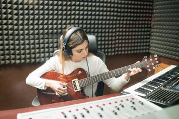 Musician preparing new sound track in recording studio