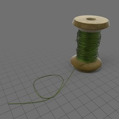 Vintage spool with thread