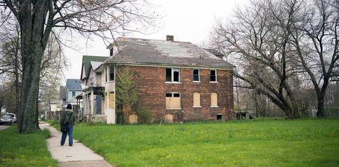 Anonymous Person Walks Sidewalk Derelict Abandoned Houses Detroit