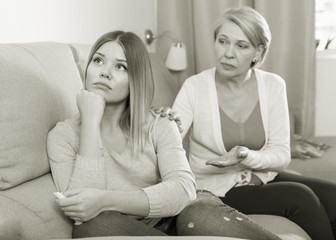 woman comforts her adult daughter