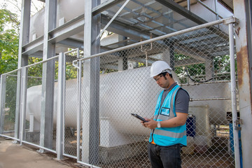Engineers work place to keep liquid helium,preventive maintenance schedule checking,Thailand people