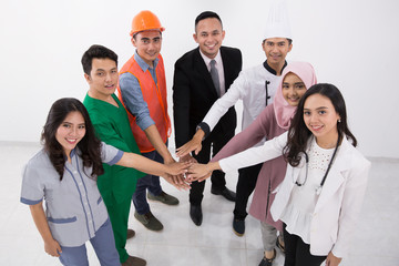 various professions people put hands together