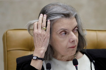Brazil's Supreme Court President Carmen Lucia gestures during a session of the Supreme Court to examine appeal seeking to prevent arrest of former president Lula, in Brasilia