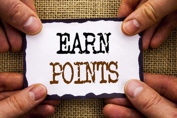 Word, writing, text  Earn Points. Conceptual photo Loyalty Reward Benefit Program For Earning Customer Point written on Sticky Note Paper Holding Hand with Finger.
