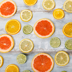 Frame of citrus fruits on white background. Flat lay, top view. Fruit's background