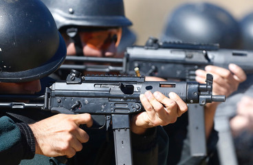 Police officers of the local prison shoot at target during a practice session at a shooting military range in Valparaiso
