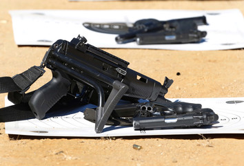 Guns are seen on a target during a practice session of the police officers of the local prison at a shooting military range in Valparaiso