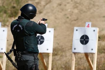 A police officer of the local prison, shoots at target during a practice session at a shooting military range in Valparaiso