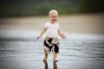 Portrait of a young toddler at the beach.