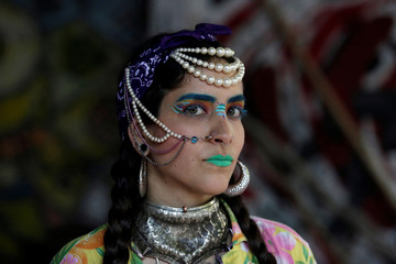 """Carmen Lazo Freyman poses for a picture wearing clothes of her creation called """"Mamarracho style"""" (Mess style) in Monterrey"""