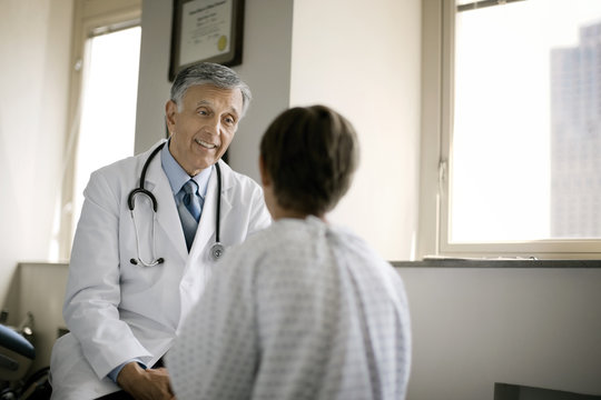 Senior doctor consulting his patient in hospital