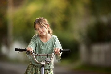 Girl riding her bicycle.