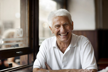 Portrait of senior man at a cafe.