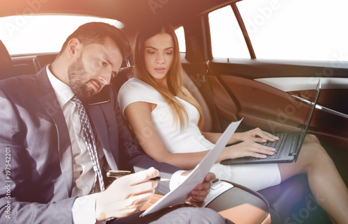 Business trip- Talking on mobile to work of car