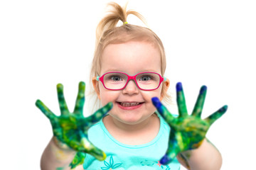 Small girl with a colorful paint on hands