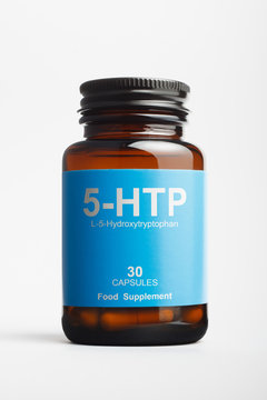 5-HTP bottle on white background